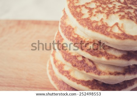 Pancakes stacked on a wooden table