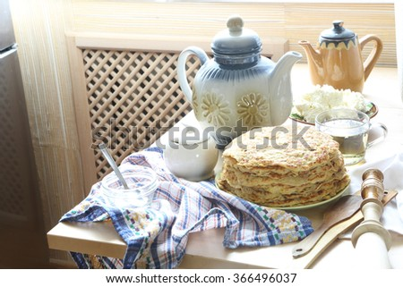 Pancakes submitted with sour cream, cottage cheese and tea.
