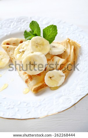 Pancakes with bananas and honey, food - stock photo