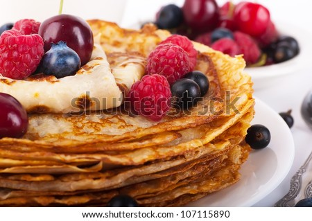 Pancakes with berries on a white background - stock photo