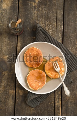 Pancakes with blueberries and maple syrup - stock photo