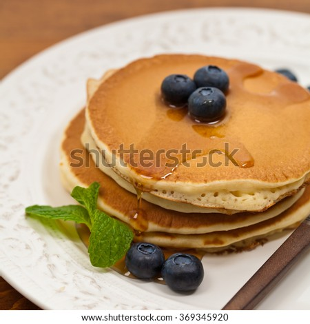 Pancakes with Blueberry. Macro with shallow dof. Selective focus. - stock photo