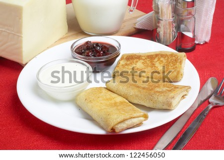 Pancakes with cheese and jam