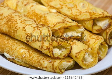 Pancakes with cheese in white plate - stock photo