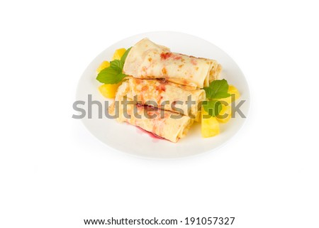 pancakes with cherry jam and pineapple slices