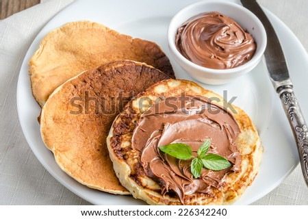 Pancakes with chocolate cream - stock photo