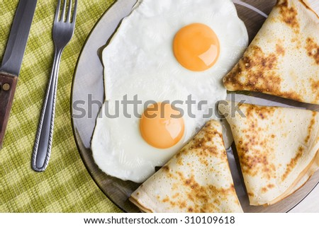 pancakes with eggs - stock photo