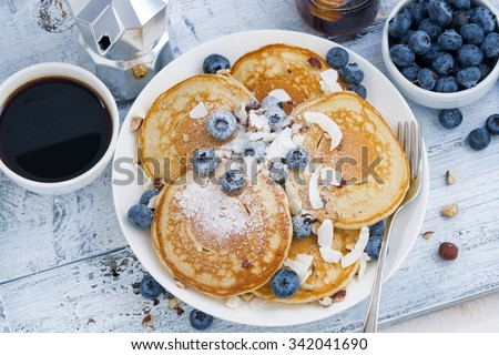 pancakes with fresh blueberries and honey for breakfast, top view, horizontal - stock photo