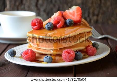 Pancakes with fruit - stock photo