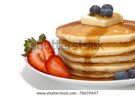 pancakes with fruits, butter and syrup - stock photo