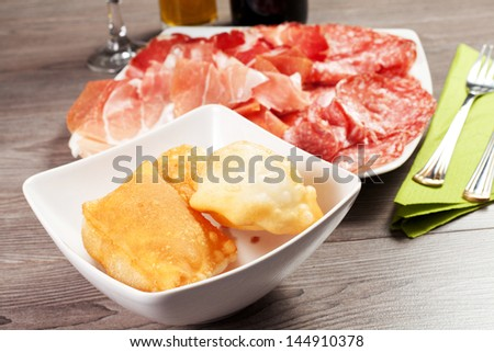 pancakes with ham and meat products on a wood table - stock photo