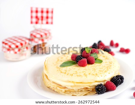 pancakes with jam and berries - stock photo