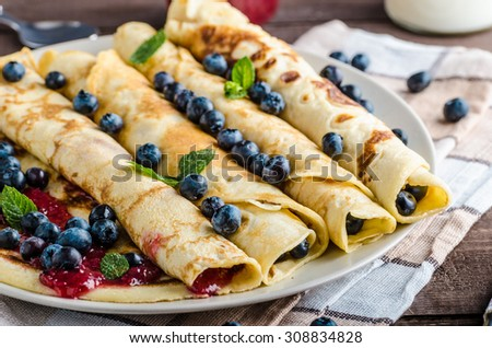 Pancakes with jam and blueberries, product photo - stock photo