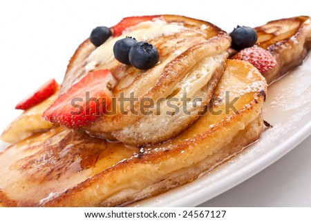 pancakes with maple syrup, melted butter and berries - stock photo