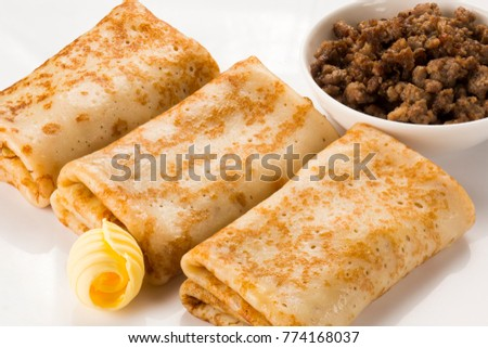 Pancakes with meat and butter