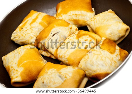 pancakes with meat fried in a saucepan - stock photo