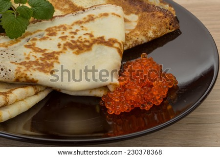 Pancakes with red caviar - famous Russian food
