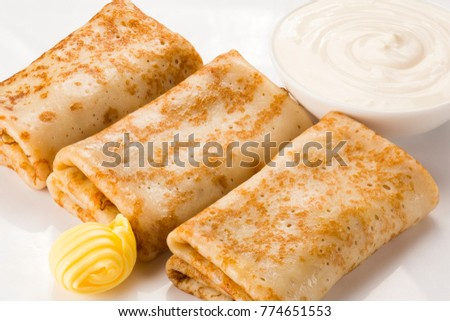 Pancakes with sour cream and butter