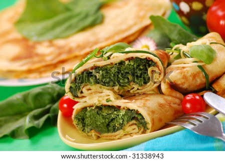 pancakes with spinach filling - stock photo