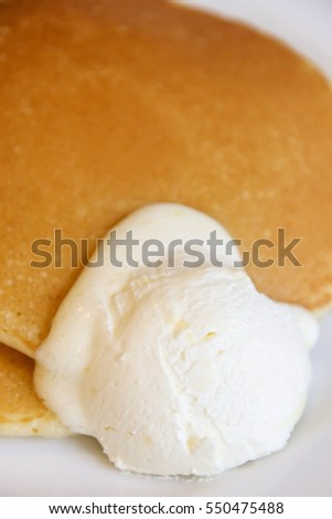 Pancakes with syrup and butter cream, the dessert in the morning.
