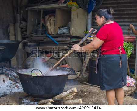 PANCHIMALCO , EL SALVADOR - MAY 08 : A Salvadoran woman cooks during the Flower & Palm Festival in Panchimalco, El Salvador on May 08 2016 - stock photo