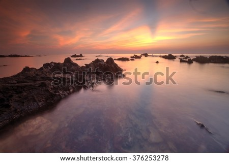 PANDAK BEACH, 25 JULY 2015. Sunrise seascape at Pandak Beach, Terengganu. Soft focus due to long exposure shot. Nature composition - stock photo