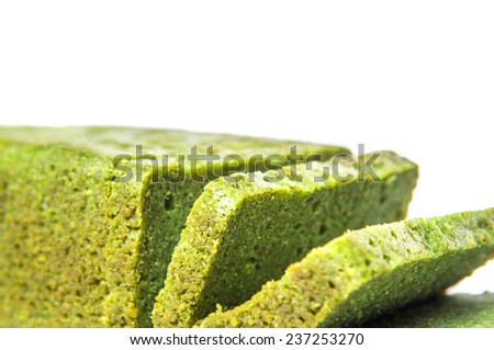 Pandan chiffon cake (flavoured with the juice of Pandanus amaryllifolius leaves) over white background