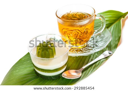 Pandan coconut and hot tea put on a green leaf. Eat to relieve hot cakes Thailand.