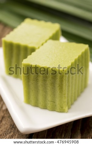 Pandan Coconut Cream Agar Agar with Pandanus Leaves in Background