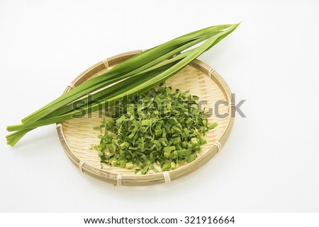 Pandan leaf or screw pine on bamboo plate. The long green fresh leaf is shredded to make herbal tea for its sweet fragrance and medicinal benefit in combat body heat, treat fever, headache and cough.  - stock photo