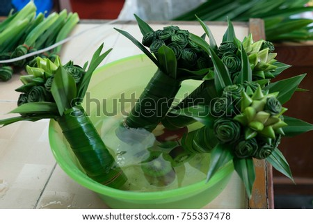 pandan leaves fold into flower for beautiful and frangrance prepare for sell on blurred pandan background