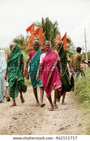 PANDHARPUR, MAHARASHTRA, INDIA - 9 JULY 2014 : Procession of Warkari-Hindu men and women Pilgrims, Warkari means Pilgrimage. The Warkari worship of Vithoba an Avatar of Vishnu.