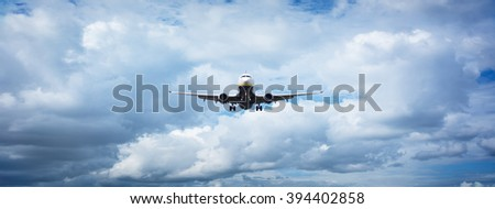 Pane flying out of the clouds - stock photo