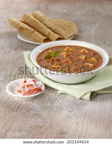 Paneer mutter gravy with roti, Indian food, India - stock photo