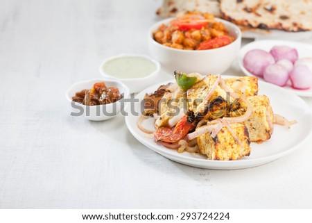 Paneer Tikka Kabab - Indian Tandoori with naan and dal - stock photo
