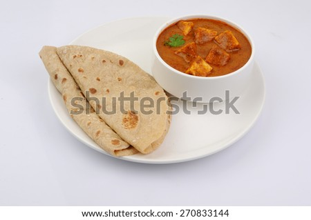 Paneer Tikka Masala, Curry, Indian food, India,Folded homemade wheat chapati (Indian bread) served with delicious Indian paneer butter masala - stock photo