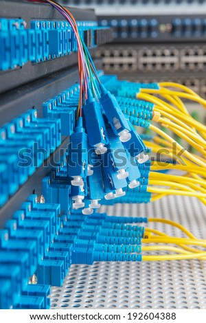 Panel of Fiber network switch with some yellow optical network cables