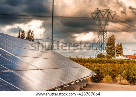 panels of a photovoltaic plant in the country - stock photo
