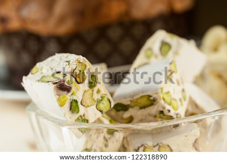 Panettone and torrone with pistachios - stock photo