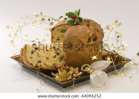 Panettone.Traditional italian Christmas cake filled with raisins and candied orange peels.