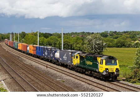 PANGBOURNE, UK - MAY 19: A Freightliner operated intermodal freight train heads toward the docks at Southampton on May 19, 2015 in Pangbourne. Freightliner operate a fleet of 80 locos & 1400 wagons