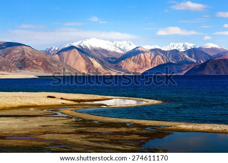 Pangong Lake in Ladakh, North India. Pangong Tso is an endorheic lake in the Himalayas situated at a height of about 4,350 m. It is 134 km long and extends from India to Tibet - stock photo