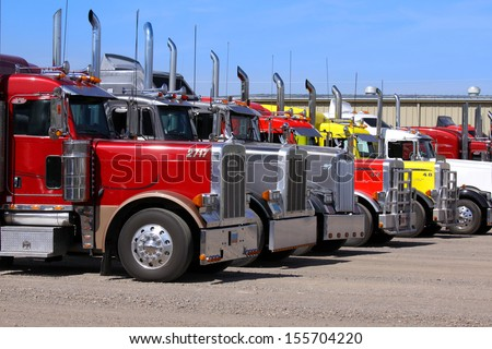Panguitch,Utah - July 20: Row of Semi trailer trucks July 20, 2009 in Panguitch,Utah, There are about 5.6 million semi trailers registered for use in the U.S. three times the number of semi trucks. - stock photo