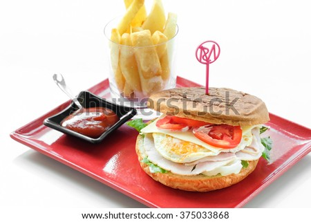 Panini English muffin with ham, cheddar cheese and fried egg   - stock photo