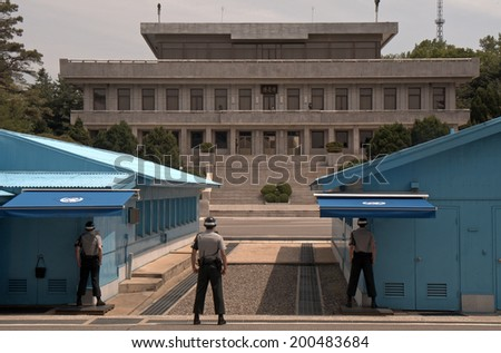 PANMUNJOM, SOUTH KOREA - MAY 17: Korean soldiers in the Joint Security Area on May 17, 2014 in Panmunjom, South Korea. The armistice agreement was signed in 1953 which divided Korea in two parts. - stock photo