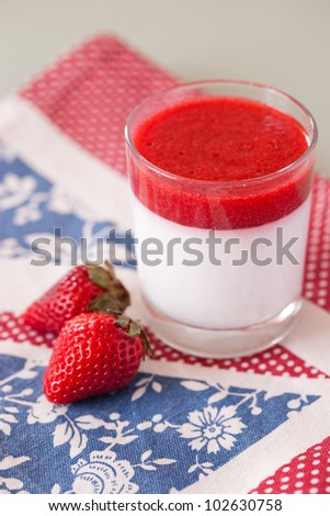 panna cotta dessert with strawberry sirup - stock photo