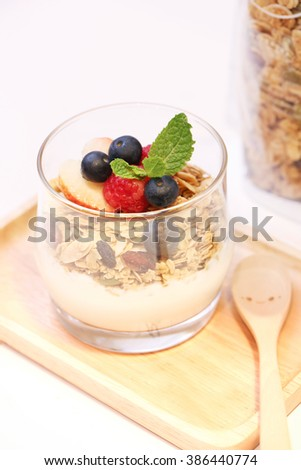 Panna cotta with Fresh forest berries in a glass on a white background isolated, Italian dessert
