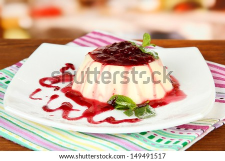 Panna Cotta with raspberry sauce, on bright background