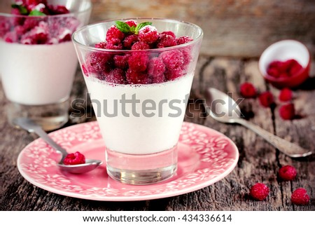 Panna cotta with raspberry toning selective focus - stock photo
