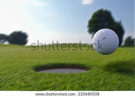 Panning golf ball - stock photo